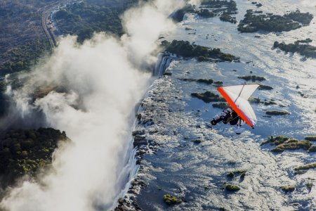 Flyings on hang glider under Victoria Falls
