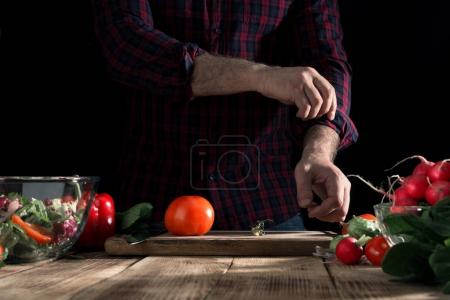 Man cooking a salad