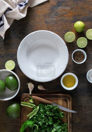Empty white plate with ingredients for cooking Mexican guacamole