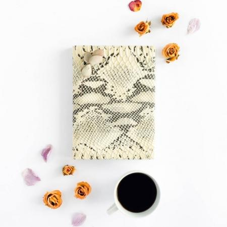 Photo for Feminine notepad with cup of coffee and dry roses on white background. Top view. Flat lay - Royalty Free Image