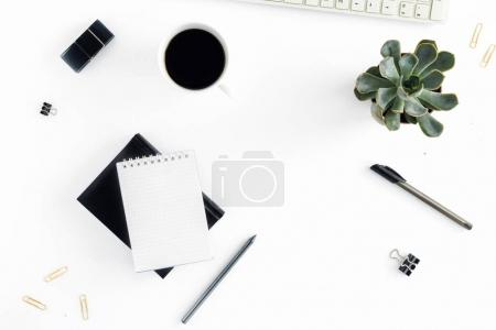 Photo for Home office workspace. Feminine workplace with keyboard, notepad, succulents, pen and cup of coffee. Office table desk. Top view. Flat lay - Royalty Free Image