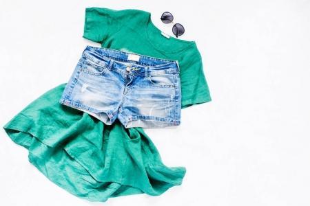 Green dress, denim shorts