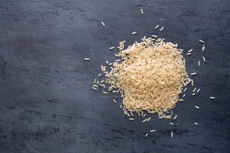 Heap of rice on a dark background