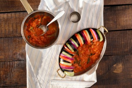 Photo for Raw ingredients for cooking vegetarian dish ratatouille on a wooden table, top view - Royalty Free Image
