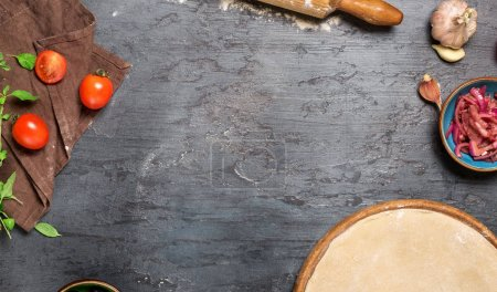 Frame of pizza dough with ingredients for cooking vegetarian piz