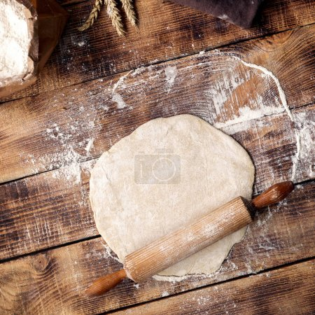 Roll out dough with rolling pin