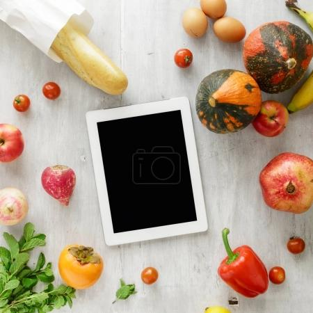 Top view raw food tablet on wooden background. Healthy food
