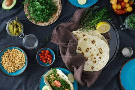 Photo for Healthy vegetarian food concept. Ingredients for cooking vegetarian pita with variety fillings, top view - Royalty Free Image