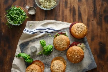 Photo for Vegetarian burgers with beet cutlets and prunes, arugula and alfalfa on wooden table, top view. Vegetarian food concept - Royalty Free Image