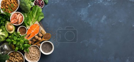 Photo for Food sources of omega 3 and healthy fats on dark background top view. Copy Space. Vegetables, seafood, nut and seed - Royalty Free Image