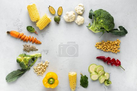 Photo for World vegan day. Frame of fresh vegetarian various ingredients for cooking vegan plate overhead view - Royalty Free Image