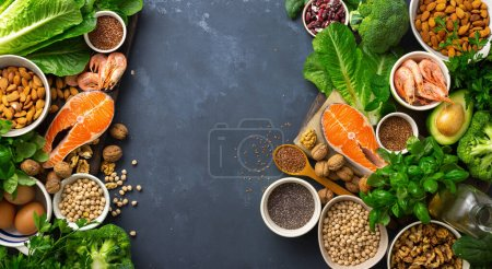 Photo for Frame of Food sources of omega 3 and omega 6. Foods high in fatty acids including vegetables, seafood, nut and seeds - Royalty Free Image