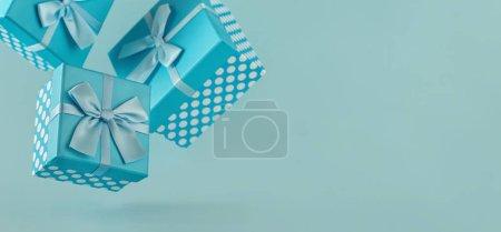 Photo pour Collection de boîtes-cadeaux à pois bleus avec rubans sur fond bleu Espace de copie - image libre de droit
