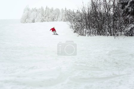 Snowboarder enjoys snow in mountains