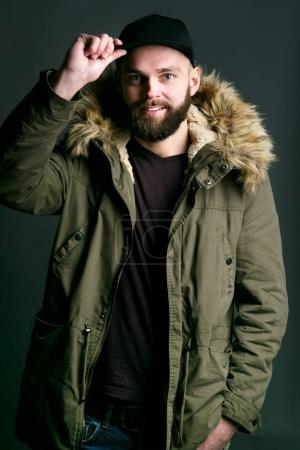 Man in parka with fur hood