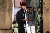 Boy in grey coat on the street