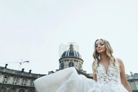 Bride whirls in a luxury wedding dress somewhere in Paris