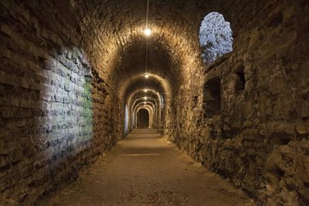 Long tunnel from stone and brick walls texture