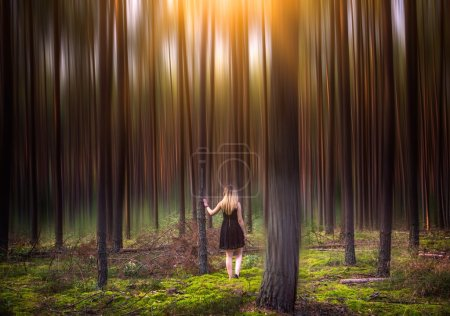 Young woman in magical forest