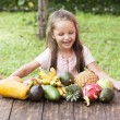 Exotic fruit on wooden table. Summer background wi...