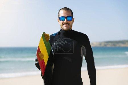 Portrait of handsome man kitesurfer.