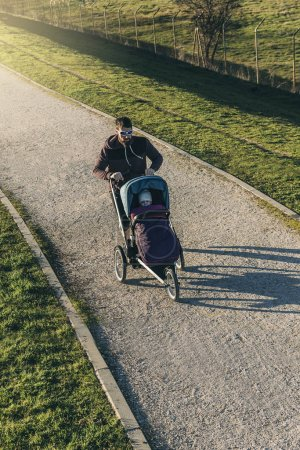 Father and son running in the park.