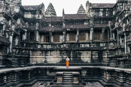 Woman Praying in Angkor Wat Temple.