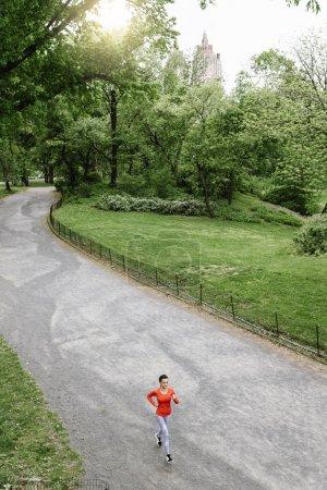 Young beautiful woman running.