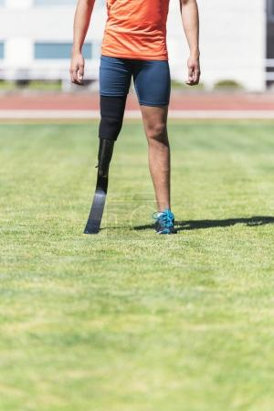 Photo for Close up disabled man athlete with leg prosthesis. Paralympic Sport Concept. - Royalty Free Image