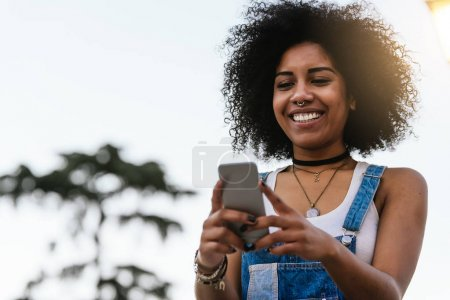 Beautiful woman using mobile in the Street.