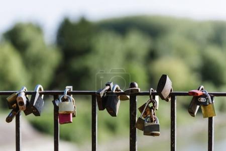 Locks of Love on a fence of bridge.