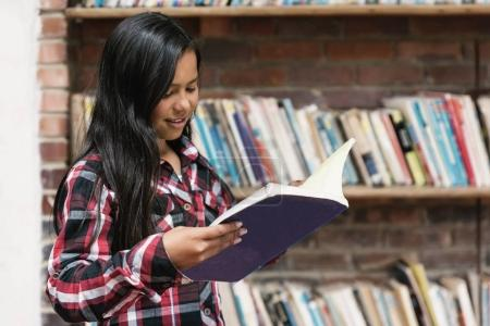 Portrait of beautiful student girl in the library.