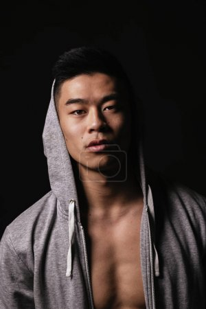 Portrait of young asian boy with sportswear.