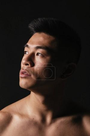 Portrait of young asian boy with fitness body.