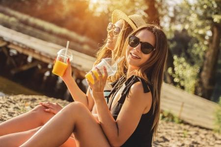 Spending carefree summer time. Two attractive youn...