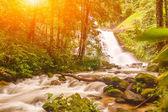 Huai Sai Lueang Waterfall with lens flare