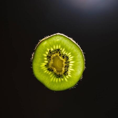 Slice of kiwi in backlight