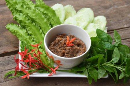 Chilli Tamarind Sauce Dip (Nam Prig Ma-kham) and vegetable.