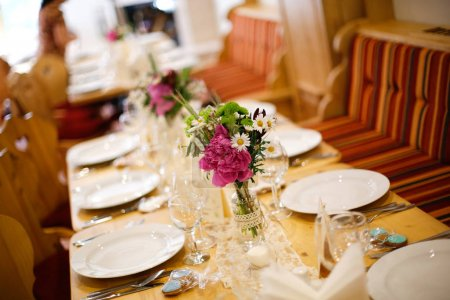Elegant dinner table with flower bouquet