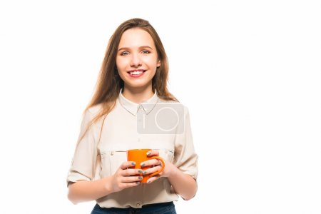 Young smiling girl holding a cup in her hands