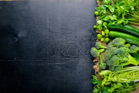 Photo for Collection of fresh green vegetables placed on black stone - Royalty Free Image