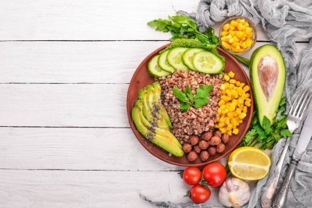 Photo for Healthy food. Buckwheat, avocado, cucumber, corn and hazelnut. On a wooden background. Top view. Free space for your text. - Royalty Free Image