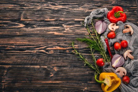 Photo for Preparation for cooking on a wooden background. Top view. Free space for text. - Royalty Free Image