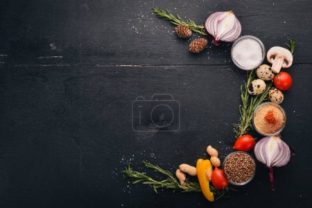 Photo for Vegetables, herbs and spices for cooking. Top view. The background of cooking. Free space for text. - Royalty Free Image