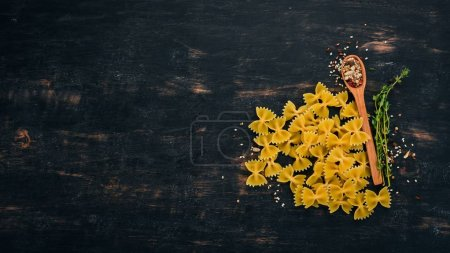 Photo for Dry pasta On a black wooden background. Italian cuisine. Top view. Copy space. - Royalty Free Image
