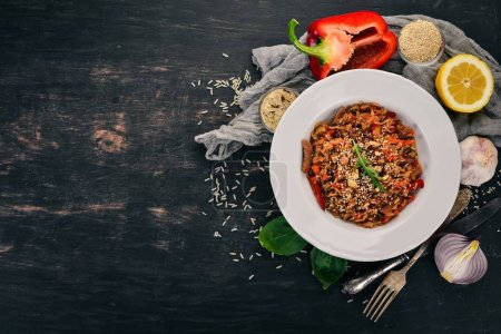 Photo for Risotto with veal and mushrooms. On a wooden background. Top view. Copy space. - Royalty Free Image