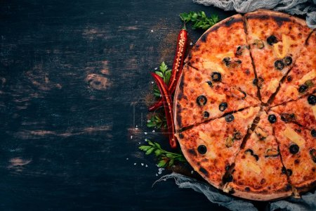 Photo for Pizza with seafood and cheese. Top view. On a wooden background. Copy space. - Royalty Free Image