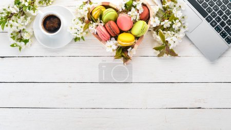 Photo for Macaroons and a fragrant cup of coffee. Top view. On a wooden background. Copy space. - Royalty Free Image