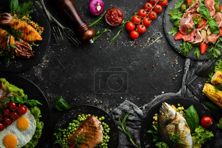 Photo for Food background. Set of dishes of fish, meat and vegetables on black stone background. Top view. Free copy space. - Royalty Free Image