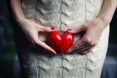 Hand female holding heart